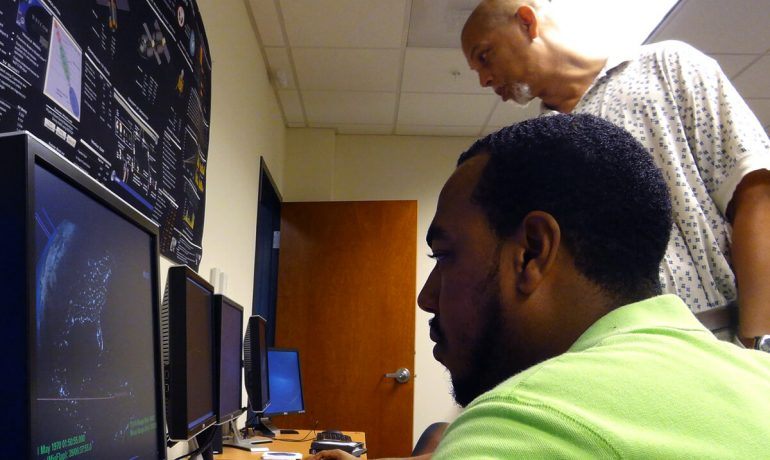 NIA Distinguished Langley Professor from North Carolina A&T, Dr. William Edmonson, reviews satellite simulations with graduate students